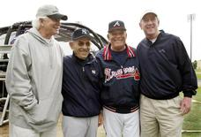 New York Yankees legend and spring coach Yogi Berra (2-L) and Atlanta Braves manager Bobby Cox (3rd L) are joined by former NFL quarterbacks Ken Stabler and Archie Manning for a picture prior to the Yankees and Braves spring training game in Kissimmee, Florida at the Walt Disney World Sports Complex March 8, 2005. REUTERS/Joe Skipper  JLS