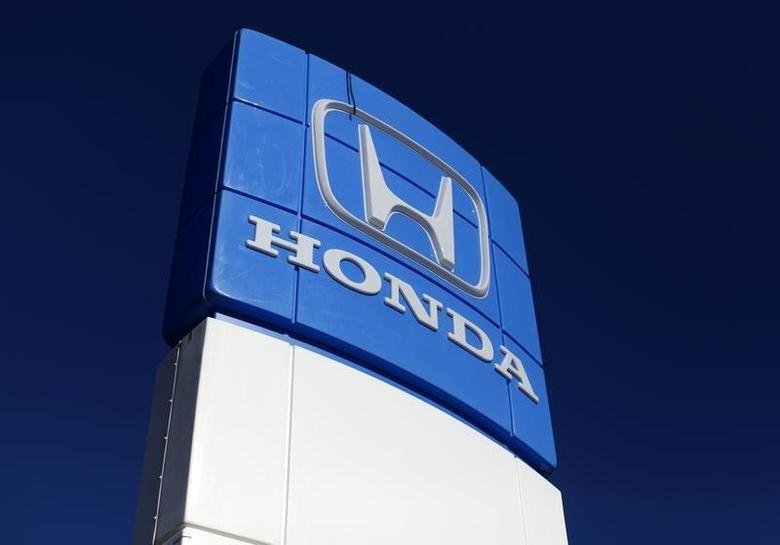 A Honda dealership sign is shown at a car lot in Carlsbad, California in this November 5, 2014 file photo. REUTERS/Mike Blake