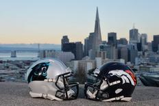 Feb 2, 2016; San Francisco, CA, USA; Carolina Panthers and Denver Broncos helmets with the San Francisco skyline and Bay Bridge as a backdrop prior to Super Bowl 50 between the Carolina Panthers and the Denver Broncos. Mandatory Credit: Kirby Lee-USA TODAY Sports