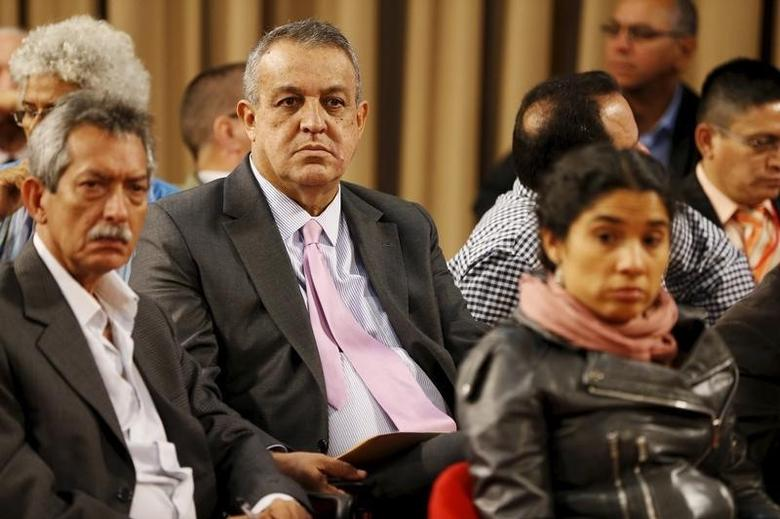 Venezuela's Oil Minister and President of the Venezuelan state oil company PDVSA, Eulogio del Pino (C), attends a meeting with entrepreneurs and representatives of the productivity sector at Miraflores Palace in Caracas January 20, 2016. REUTERS/Carlos Garcia Rawlins
