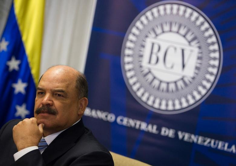 Venezuela's Central Bank President Nelson Merentes attends to a news conference at the headquarters of the Central Bank in Caracas February 8, 2013. REUTERS/Carlos Garcia Rawlins