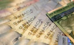 An illustration picture shows Canadian banknotes of five Dollars in Reykjavik March 6, 2012.  REUTERS/Ingolfur Juliusson