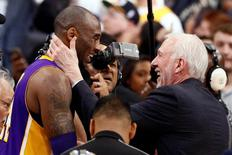 Feb 6, 2016; San Antonio, TX, USA; Los Angeles Lakers small forward Kobe Bryant (24) hugs San Antonio Spurs head coach Gregg Popovich after the game at AT&T Center. Mandatory Credit: Soobum Im-USA TODAY Sports