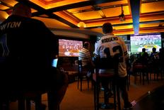Australian NFL fans watch the telecast of the NFL Super Bowl on a large screen at the Western Suburbs Leagues Club in Leumeah, located west of Sydney, Australia, February 8, 2016.  REUTERS/David Gray