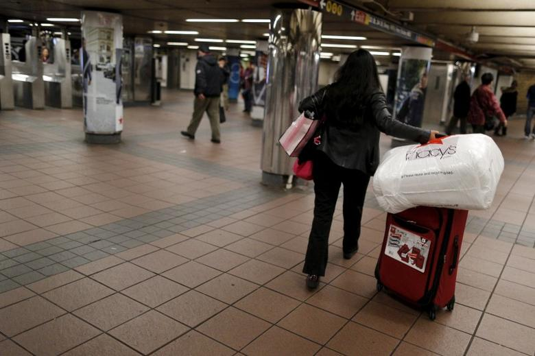 A shopper walks through the Herald Square Subway station after early morning Black Friday Shopping in New York, November 27, 2015. REUTERS/Brendan McDermid
