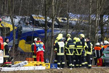 Members of emergency services stand next to a crashed train near Bad Aibling in southwestern Germany, February 9, 2016. REUTERS/Michael Dalder