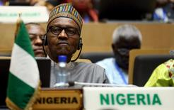 Nigeria's President Muhammadu Buhari attends the opening ceremony of the 26th Ordinary Session of the Assembly of the African Union at the AU headquarters in Ethiopia's capital Addis Ababa, January 30, 2016. REUTERS/Tiksa Negeri