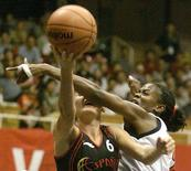 USA's Sheryl Swoopes fouls Spain's Laia Palau (6) during their quarter final match at the 14th Womens Basketball World Championship in Nanjing, the capital city of Jiangsu province, China September 23, 2002.   REUTERS/Claro Cortes IV