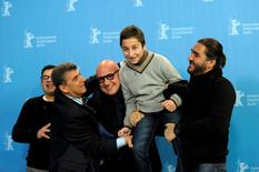 Giuseppe Fragapane, Pietro Bartolo, director Gianfranco Rosi, Samuele Pucillo and Giuseppe del Volgo (L-R) pose during a photocall to promote the movie 'Fuocoammare' (Fire at Sea) at the 66th Berlinale International Film Festival in Berlin, Germany February 13, 2016. REUTERS/Stefanie Loos