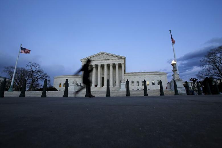 A woman walks past the Supreme Court building at Capitol Hill in Washington D.C., February 13, 2016. REUTERS/Carlos Barria  . SAP is the sponsor of this content. It was independently created by Reuters' editorial staff and funded in part by SAP, which otherwise has no role in this coverage.