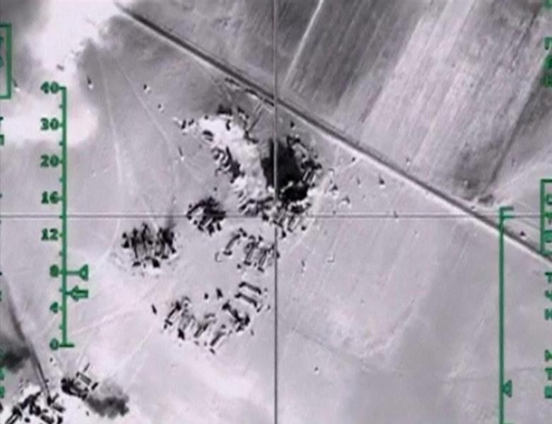 Still image taken from aerial footage released by Russia's Defence Ministry on February 11, 2016, shows airstrikes, carried out by the country's air force and hitting what the Defence Ministry says were Islamic State oil storage facilities, at an unknown location in Syria. REUTERS/Ministry of Defence of the Russian Federation/Handout via Reuters/Files