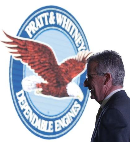 Pratt and Whitney's President Bob Leduc passes a signage during the opening ceremony of their first manufacturing facility in Singapore February 15, 2016.  REUTERS/Edgar Su