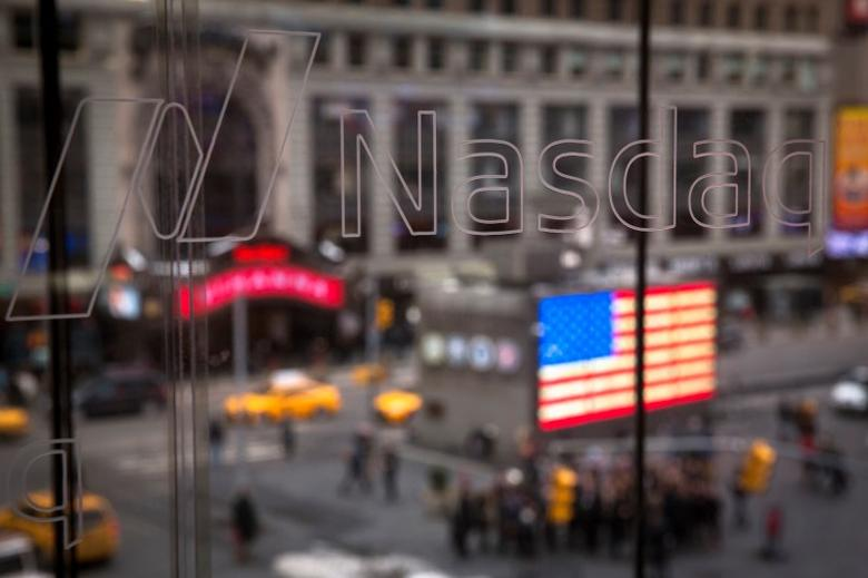 The Nasdaq logo is etched into glass at the headquarters for the Nasdaq in New York March 3, 2015. REUTERS/Lucas Jackson