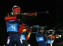 Russia's Anton Shipulin shoots during the men's biathlon 4 x 7.5 km relay at the Sochi 2014 Winter Olympic Games February 22, 2014.          REUTERS/Sergei Karpukhin (RUSSIA  - Tags: OLYMPICS SPORT BIATHLON)   - RTX19B1J