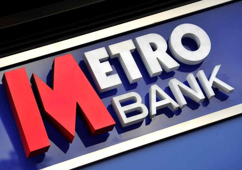 A logo is seen on the outside of a branch of Metro Bank in central London July 28, 2010. REUTERS/Toby Melville
