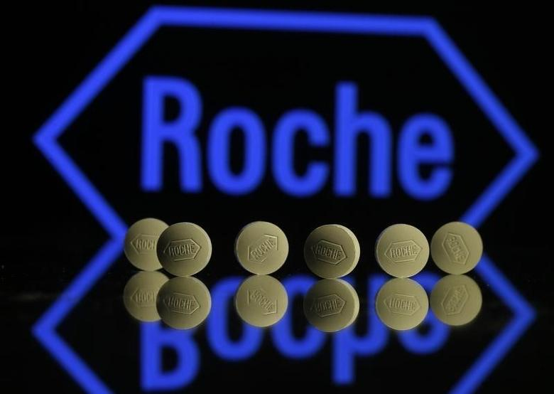 Roche tablets are seen positioned in front of a displayed Roche logo in this photo illustration shot in Zenica, Bosnia and Herzegovina, January 22, 2016. REUTERS/Dado Ruvic