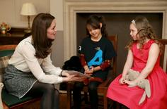 "Britain's Catherine, Duchess of Cambridge speaks with Solei Neil-Brown and Kiera Mullins (R) from the ""Real Truth"" video blog that features on the Huffington Post website, at Kensington Palace in London, Britain February 17, 2016. REUTERS/Chris Jackson/pool"