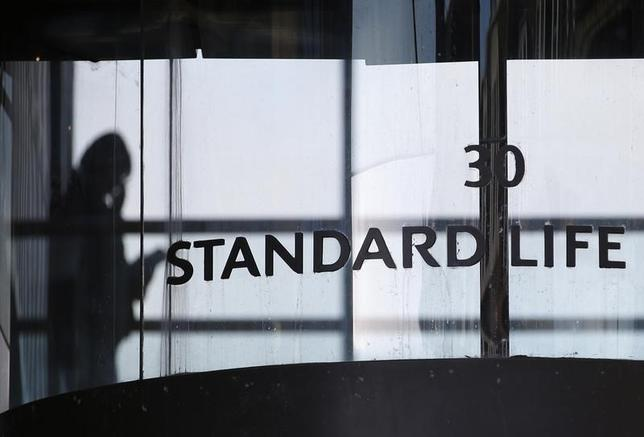 A worker walks inside the Standard Life House in Edinburgh, Scotland February 27, 2014. REUTERS/Russell Cheyne