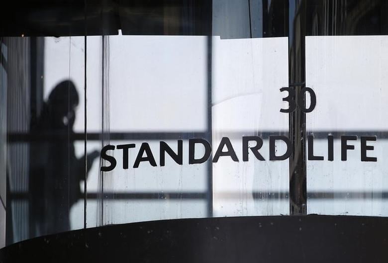 A worker walks inside the Standard Life House in Edinburgh, Scotland February 27, 2014. REUTERS/Russell Cheyne