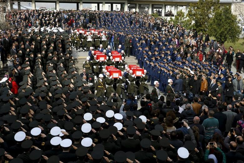 Honour guards carry Turkish flag-draped coffins of car bombing victims during a funeral ceremony at Kocatepe mosque in Ankara, Turkey February 19, 2016. REUTERS/Umit Bektas