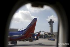 Southwest Airlines planes are seen through the window of a plane at LAX airport in Los Angeles, California, United States, October 22, 2015. REUTERS/Lucy Nicholson