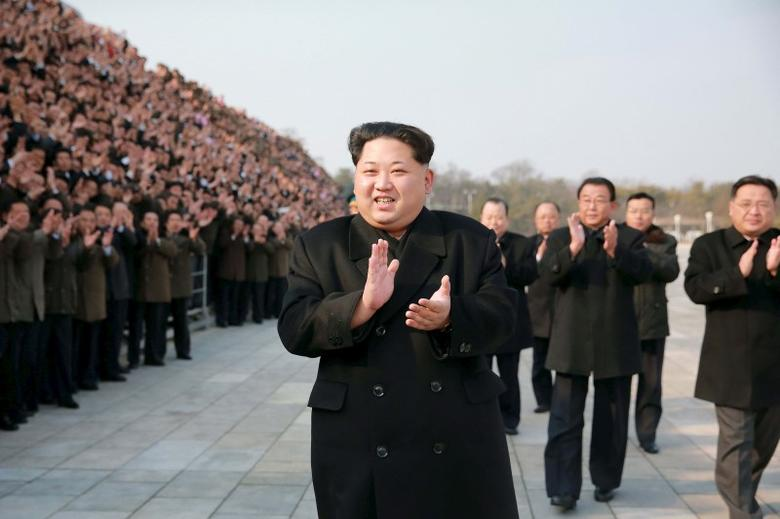 North Korean leader Kim Jong Un (C) attends a photo session with the scientists, technicians, workers of earth observation satellite Kwangmongsong-4 in this undated file photo released by North Korea's Korean Central News Agency (KCNA) on February 19, 2016.   REUTERS/KCNA