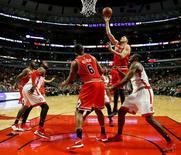Feb 19, 2016; Chicago, IL, USA; Chicago Bulls forward Doug McDermott (3) shoots against the Toronto Raptors during the second half at United Center. Mandatory Credit: Kamil Krzaczynski-USA TODAY Sports
