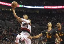 Feb 19, 2016; Portland, OR, USA; Portland Trail Blazers guard Damian Lillard (0) drives to the basket on Golden State Warriors guard Shaun Livingston (34) and center Marreese Speights (5) during the third quarter of the game at the Moda Center at the Rose Quarter. Lillard scored 51 points as the Blazers won 137-105. Mandatory Credit: Steve Dykes-USA TODAY Sports