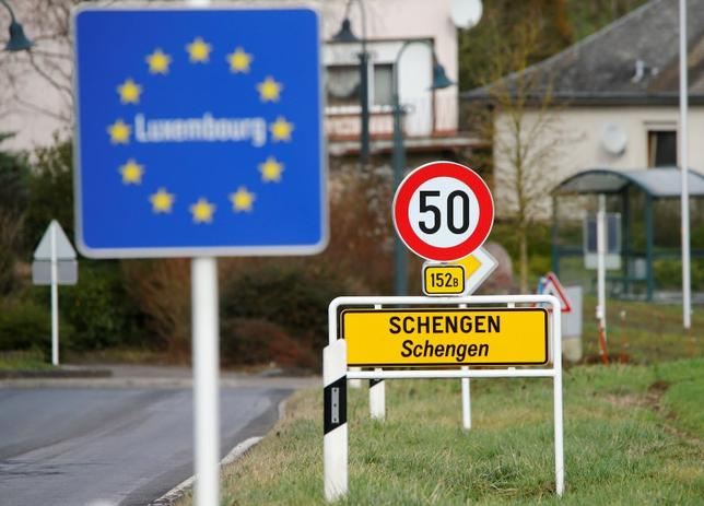A street sign marks the beginning of Schengen, Luxembourg January 27, 2016. REUTERS/Wolfgang Rattay