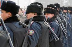 Police officers line up during an opposition rally in Almaty February 25, 2012. REUTERS/Shamil Zhumatov