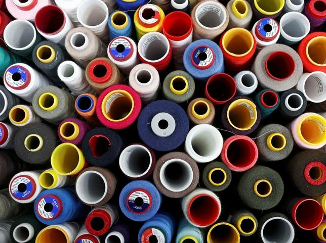 Coloured cotton reels are seen at the Fashion Enter factory in London England, January 8, 2016.   REUTERS/Eddie Keogh