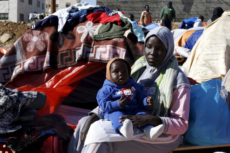 Sudanese refugees from Darfur sit near their tent in an open-ended sit-in in outside the United Nations High Commissioner for Refugees (UNHCR) office, demanding better treatment and acceleration of their relocation, in Amman, Jordan December 11, 2015. REUTERS/Muhammad Hamed