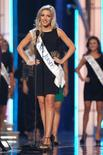 Miss America 2014 contestant, Miss New Jersey Cara McCollum stands on stage during the Miss America Pageant in Atlantic City, New Jersey, September 10, 2013. REUTERS/Carlo Allegri