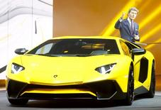 Stephan Winkelmann, President and CEO of Lamborghini, speaks next to the new Aventador car during a Volkswagen Group event ahead of the 85th International Motor Show in Geneva, March 2, 2015. REUTERS/Arnd Wiegmann