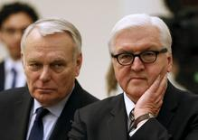 German Foreign Minister Frank-Walter Steinmeier (R) and French Foreign Minister Jean-Marc Ayrault gather before a meeting with Ukrainian Prime Minister Arseny Yatseniuk (not pictured), in Kiev, Ukraine, February 22, 2016.  REUTERS/Gleb Garanich