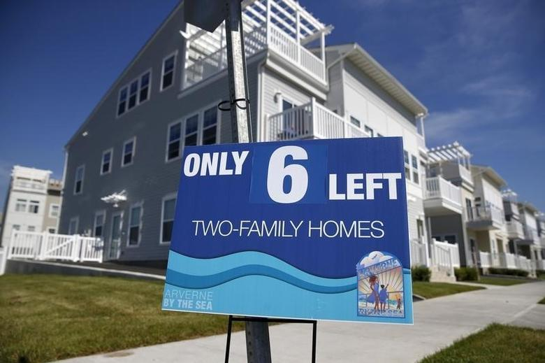 An advertisement for two-family homes is seen outside an oceanside community  in the Rockaway area of the Queens borough of New York, September 16, 2015.   REUTERS/Shannon Stapleton