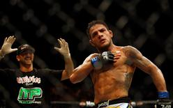 Rafael Dos Anjos of Brazil celebrates victory after his bout against Terry Etim of Britain during the Ultimate Fighting Championship tournament in Abu Dhabi April 10, 2010. REUTERS/Mohammed Salem