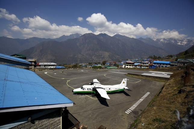 A Twin Otter aircraft belonging to Tara Air is pictured at Tenzing Hillary Airport, in Lukla, approximately 2800 meters above sea level, in Solukhumbu district, Nepal, in this file picture taken April 25, 2014. REUTERS/Navesh Chitrakar/Files