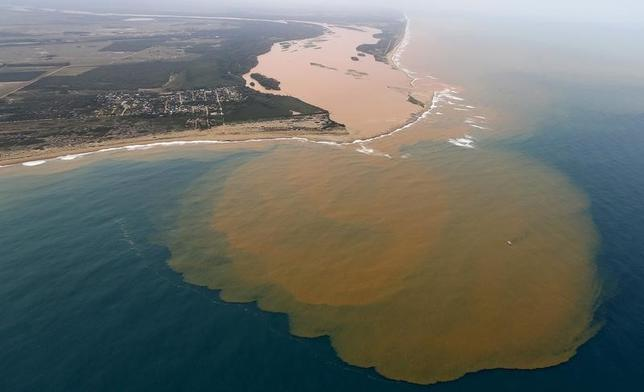 An aerial view of the Rio Doce (Doce River), which was flooded with mud after a dam owned by Vale SA and BHP Billiton Ltd burst, at an area where the river joins the sea on the coast of Espirito Santo in Regencia Village, Brazil, November 23, 2015. REUTERS/Ricardo Moraes