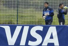 A Visa advertising banner is pictured as Italy's national soccer goalkeepers Gianluigi Buffon and Salvatore Sirigu drink during a training session ahead of the 2014 World Cup at the Portobello training center in Mangaratiba June 10, 2014. REUTERS/Alessandro Garofalo