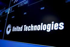 The ticker symbol for United Technologies is displayed on a screen on the floor of the New York Stock Exchange July 20, 2015. REUTERS/Brendan McDermid