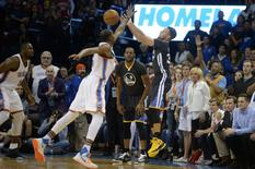Feb 27, 2016; Oklahoma City, OK, USA; Golden State Warriors guard Stephen Curry (30) attempts a three point shot against Oklahoma City Thunder forward Kevin Durant (35) during the fourth quarter at Chesapeake Energy Arena. Mandatory Credit: Mark D. Smith-USA TODAY Sports