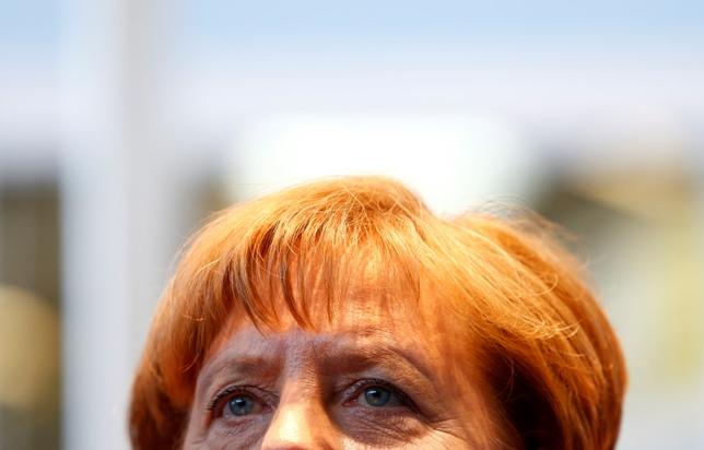 German Chancellor and head of the Christian Democratic Union (CDU) Angela Merkel addresses a news conference after a meeting at the International Trade Fair in Munich, Germany, February 26, 2016.  REUTERS/Michaela Rehle