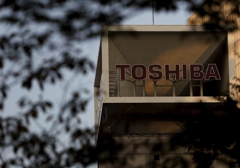 The logo of Toshiba Corp is seen behind trees at its headquarters in Tokyo, Japan, November 6, 2015. REUTERS/Yuya Shino