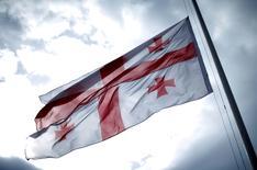 Georgian national flag waves at half-mast marking the anniversary of Georgia's occupation by the Soviet Army in 1921, outside Tbilisi, Georgia, February 25, 2016. REUTERS/David Mdzinarishvili - RTX28IH6