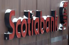 Snow covers the Scotiabank logo at the Bank of Nova Scotia headquarters in Toronto in this file photo taken on December 16, 2013. REUTERS/Chris Helgren