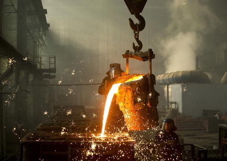 A worker fills molds with molten iron at an iron foundry in Bobruisk, southeast of Minsk, March 11, 2015. REUTERS/Vasily Fedosenko