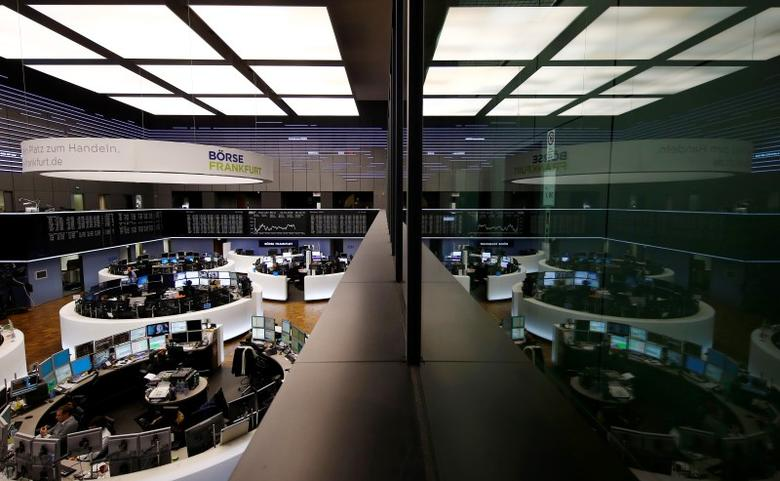The trading room of Frankfurt's stock exchange (Boerse Frankfurt) is reflected in the window of the visitor's gallery during afternoon trading session in Frankfurt Germany, February 23, 2016.    REUTERS/Kai Pfaffenbach