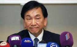 AIBA President Wu Ching-Kuo attends a news conference in Baku in this file photo dated September 24, 2011. REUTERS/Osman Karimov