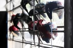 Boxing headgear is seen hanging on window grills as the Great Britain's Olympic boxing team practices at Santo Amaro club in Sao Paulo February 9, 2012.  REUTERS/Fernando Donasci
